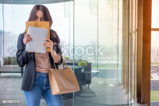 istock Beautiful Asia business woman over blue office background. 857652272