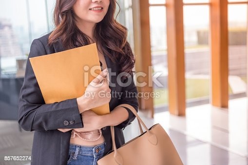 istock Beautiful Asia business woman over blue office background. 857652274