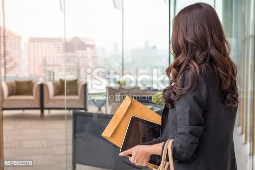 istock Beautiful Asia business woman over blue office background. 857652276