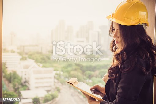 istock Beautiful Asia business woman over blue office background. 857652280