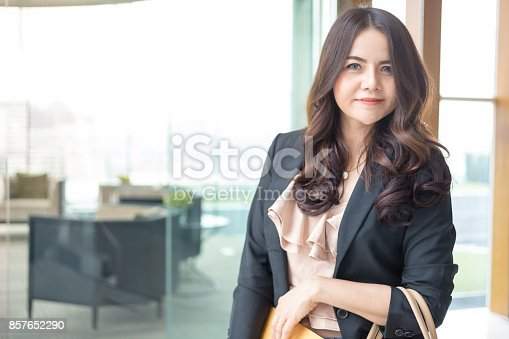 istock Beautiful Asia business woman over blue office background. 857652290
