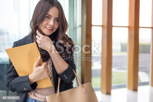 istock Beautiful Asia business woman over blue office background. 857659530