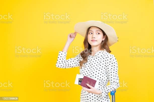 Beautiful asia woman happy smiley holding passport bording pass girl picture id1202299608?b=1&k=6&m=1202299608&s=612x612&h=gasuzjhujoars2fiufm0tzgnx7tfrax8nevfnzwv1lk=