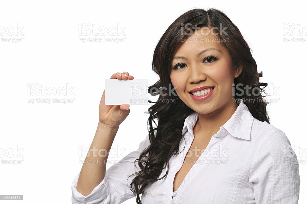 Beautiful asian businesswoman with blank card royalty-free stock photo