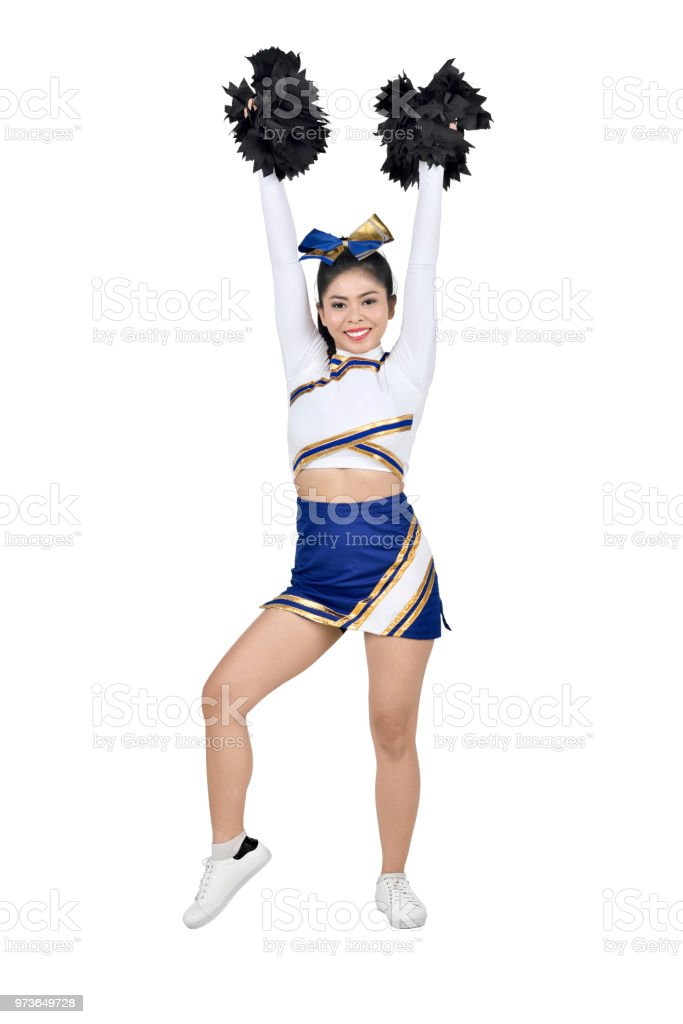 Beautiful asian cheerleader with hands in the air with pom-poms stock photo