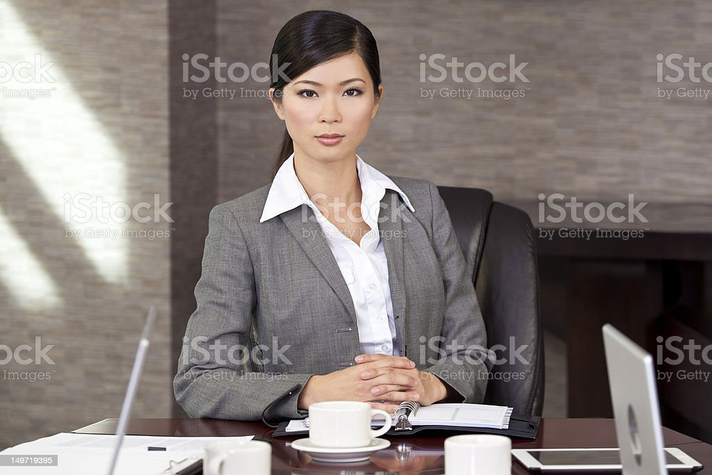 Beautiful Asian Chinese Businesswoman At Boardroom Table royalty-free stock photo