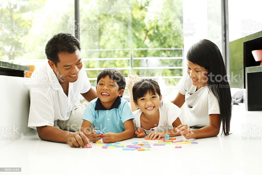 Beautiful Asian family enjoying at home. stock photo