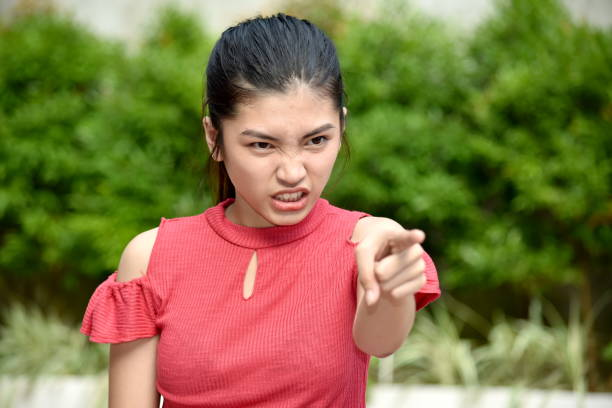 A Beautiful Asian Girl And Anger A person in an outdoor setting antagonize stock pictures, royalty-free photos & images