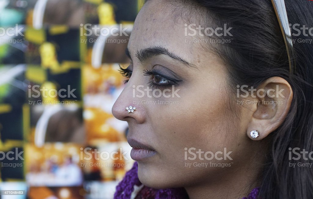 Sultry looking British Asian girl on London's South Bank stock photo