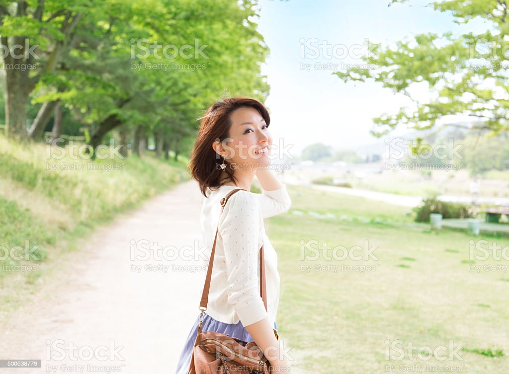 Beautiful asian girl smiling in the park stock photo