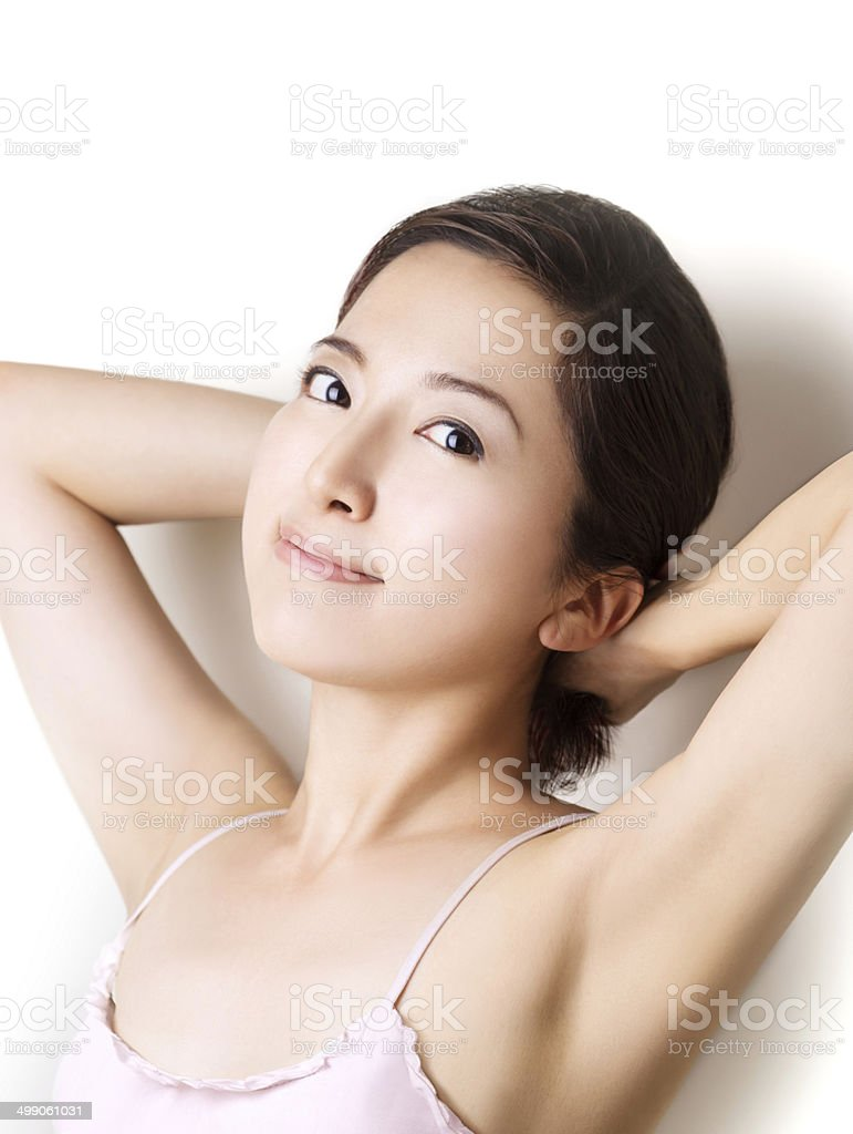 Beautiful asian girl touching her hair. Smiling at camera stock photo