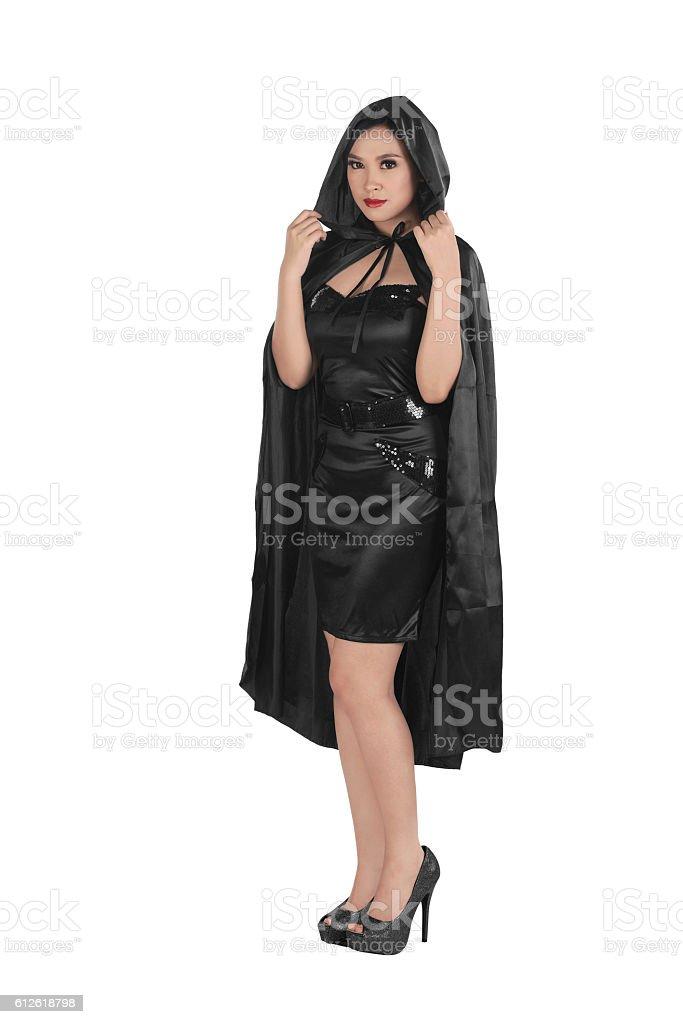 Beautiful asian girl wearing a black hooded cloak stock photo