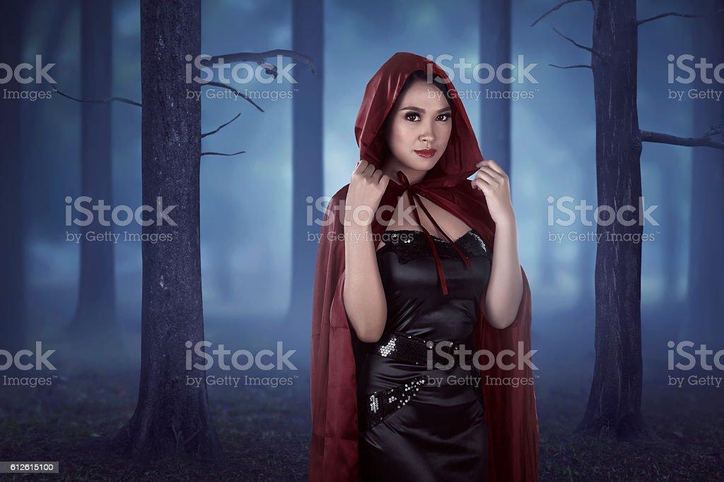 Beautiful asian girl wearing a red hooded cloak stock photo