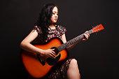 Portrait of beautiful asian guitarist