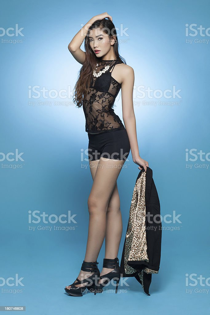 Beautiful asian lady in classy fashion wear royalty-free stock photo