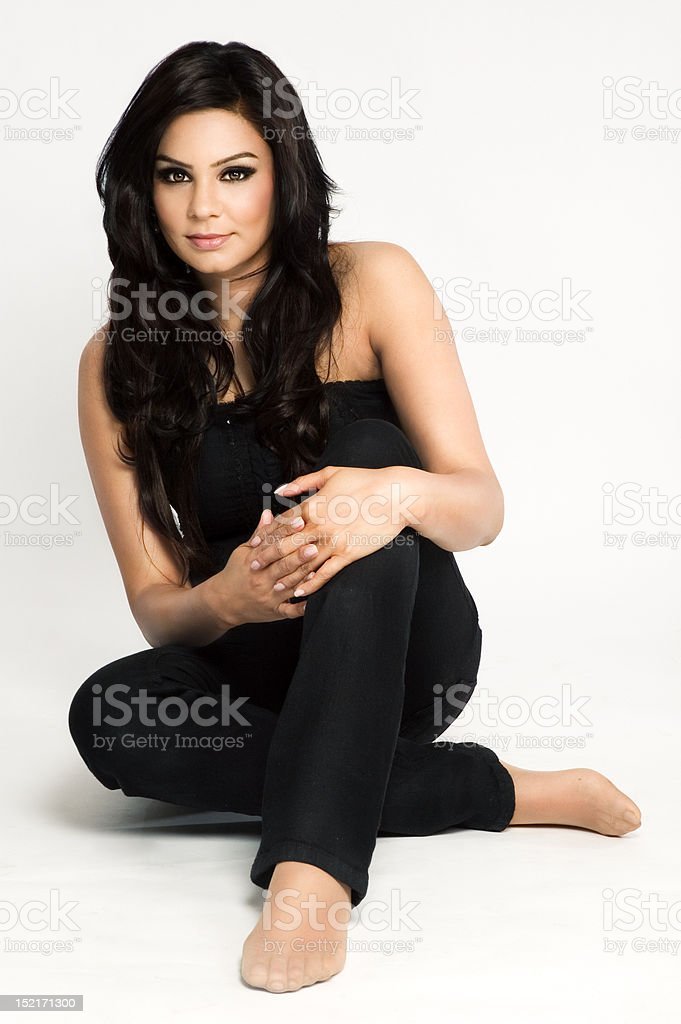 Beautiful Asian model sitting on the floor royalty-free stock photo