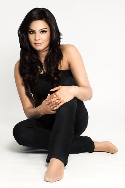 Beautiful Asian model sitting on the floor stock photo