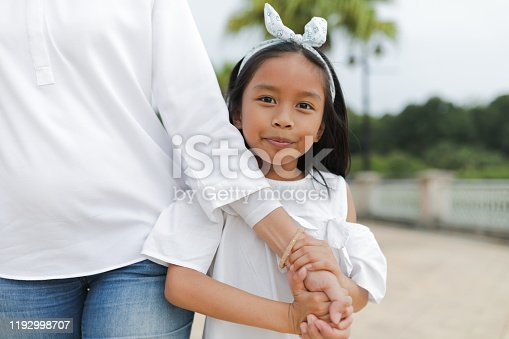 Beautiful asian single mother with children at park