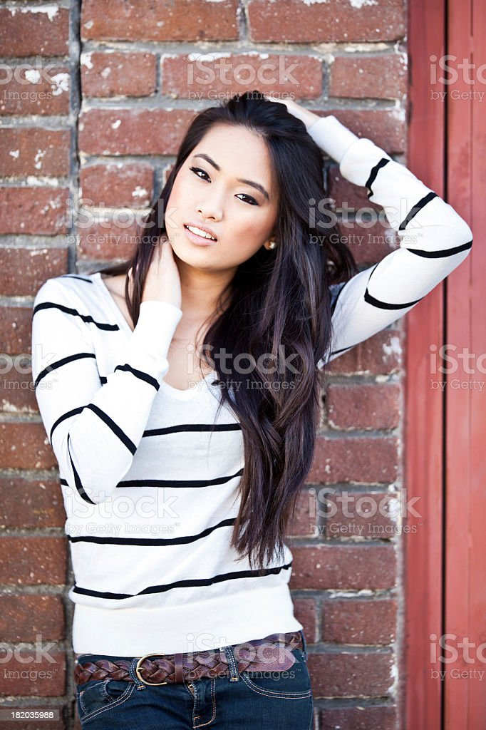 beautiful asian teen pulling her hair back royalty-free stock photo