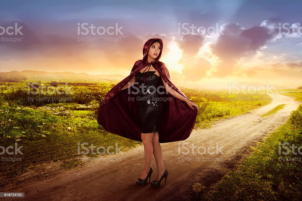 Beautiful asian witch woman with black hood stock photo