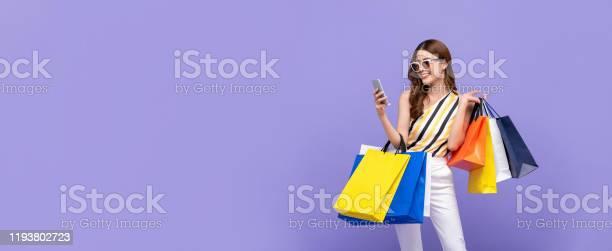 Beautiful asian woman carrying colorful bags shopping online with picture id1193802723?b=1&k=6&m=1193802723&s=612x612&h=iduaujsk9q kawg3cl0wznbwshcva5hehskh 8mwi g=