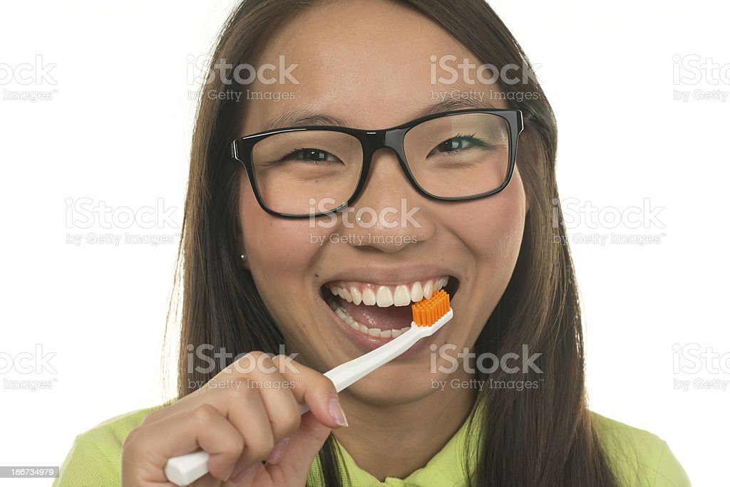 Beautiful Asian Woman Cleaning Her Teeth royalty-free stock photo