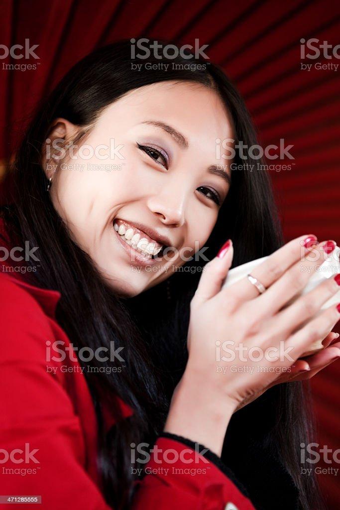 Beautiful asian woman drinking tea royalty-free stock photo