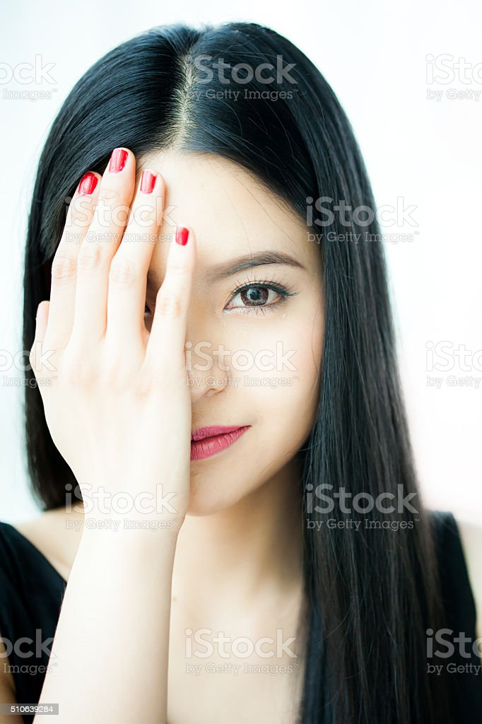 Beautiful Asian woman face in white background - beauty concept stock photo