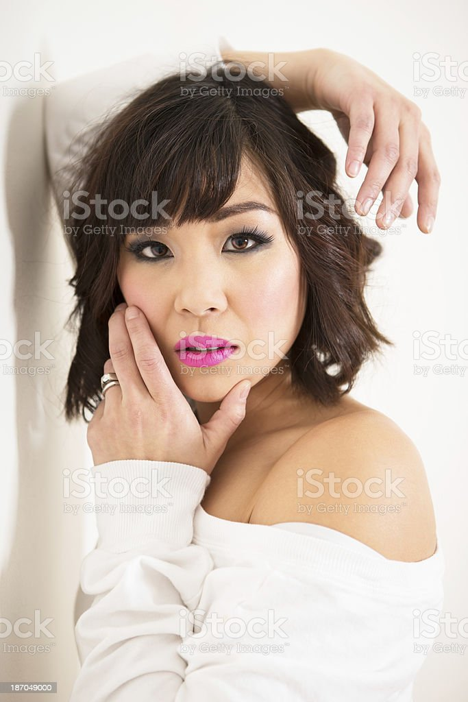 Beautiful asian woman leaning on wall royalty-free stock photo