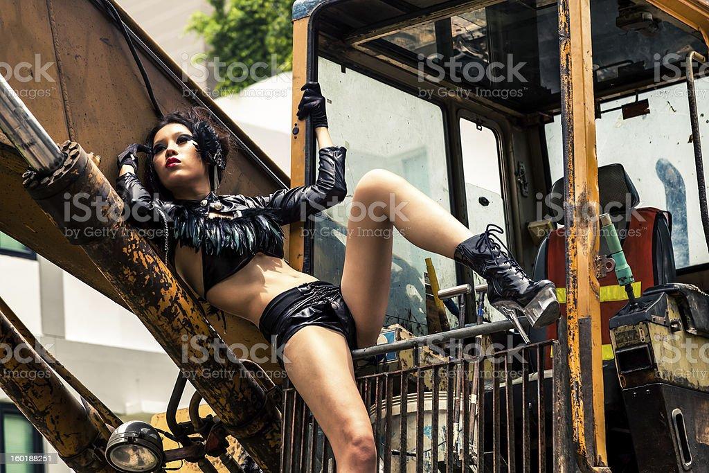 Beautiful Asian Woman on Excavator stock photo