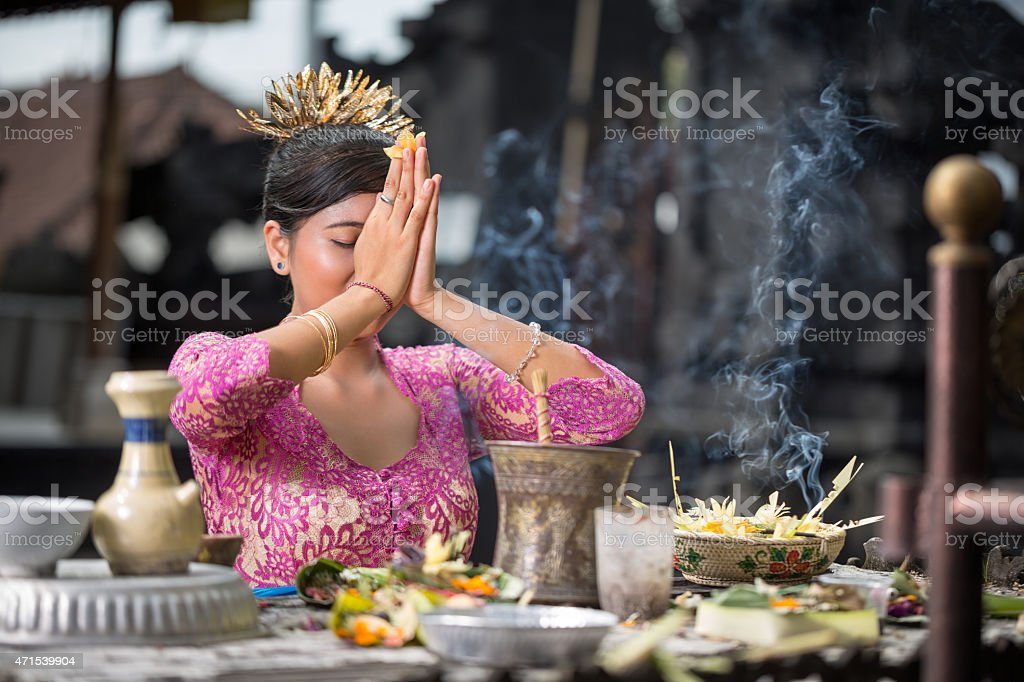 Beautiful Asian woman prays in the temple stock photo