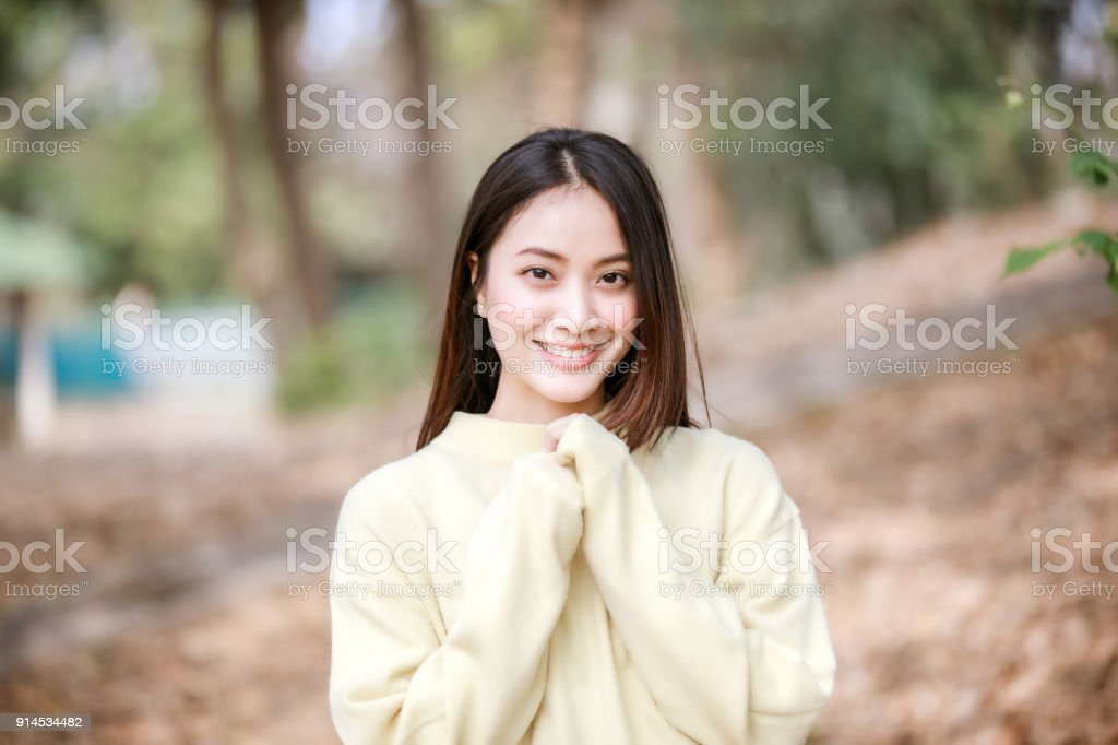 0dd97f8d9f Beautiful Asian woman Smiling happy girl and wearing warm clothes winter and  autumn portrait at outdoor
