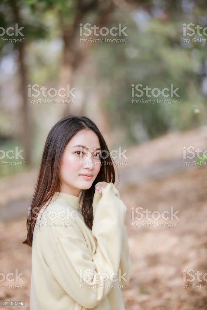 456a4566c6 Beautiful Asian woman Smiling happy girl and wearing warm clothes winter and  autumn portrait at outdoor in park - Stock image .