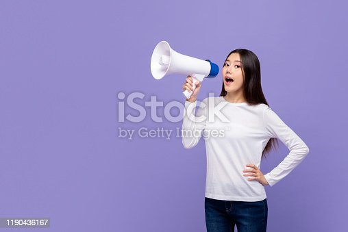 1166716628 istock photo Beautiful Asian woman talking on magaphone 1190436167