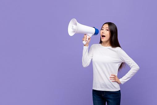 1166716628 istock photo Beautiful Asian woman talking on magaphone 1190436167