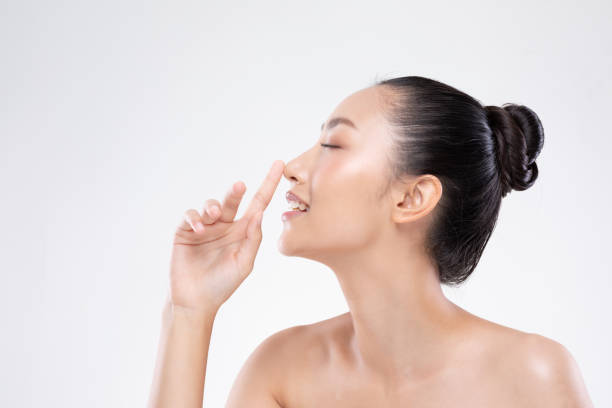 beautiful asian woman touching nose smile with clean and fresh skin happiness and cheerful with positive emotional,isolated on white background,beauty and cosmetics concept - naso foto e immagini stock