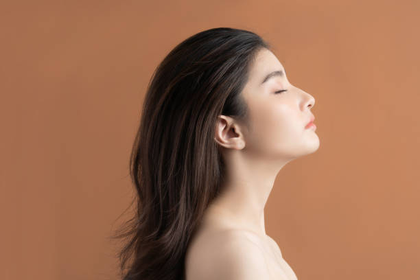 Beautiful asian woman with a beautiful face . Side view stock photo