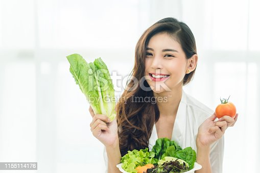 Beautiful Asian woman with healthy food. Heathy life style and Beautiful skin care food concept.