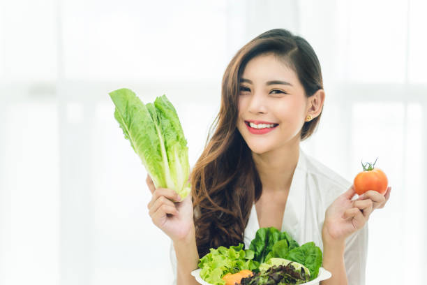 Beautiful Asian woman with healthy food. Heathy life style and Beautiful skin care food concept. stock photo