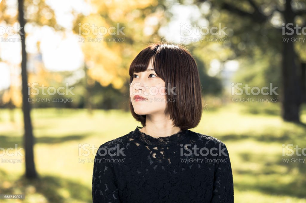 Beautiful Asian women feeling relaxed royalty-free stock photo