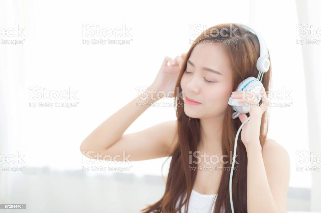 Beautiful Asian Young Woman Enjoy Listen Music With