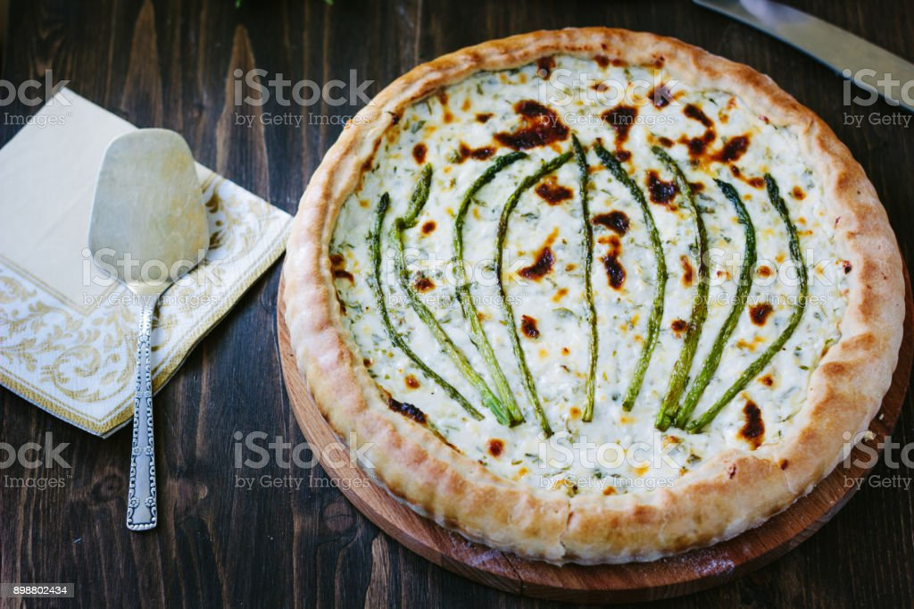 Beautiful asparagus tart - fresh pie with asparagus and goat cheese stock photo