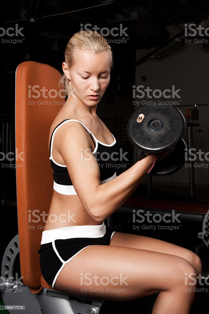 Beautiful athlete lifting heavy weights royalty-free stock photo