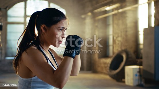 istock Beautiful Athletic Woman holds her Arms Ready for Defending Herself. It is a Part of Her Intensive Cross Fitness Gym Training. 844485646