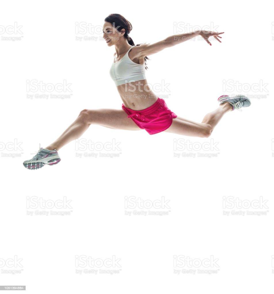 Schöne Sportliche Frau Springen Seitwärts Und Mit Weit Gespreizten