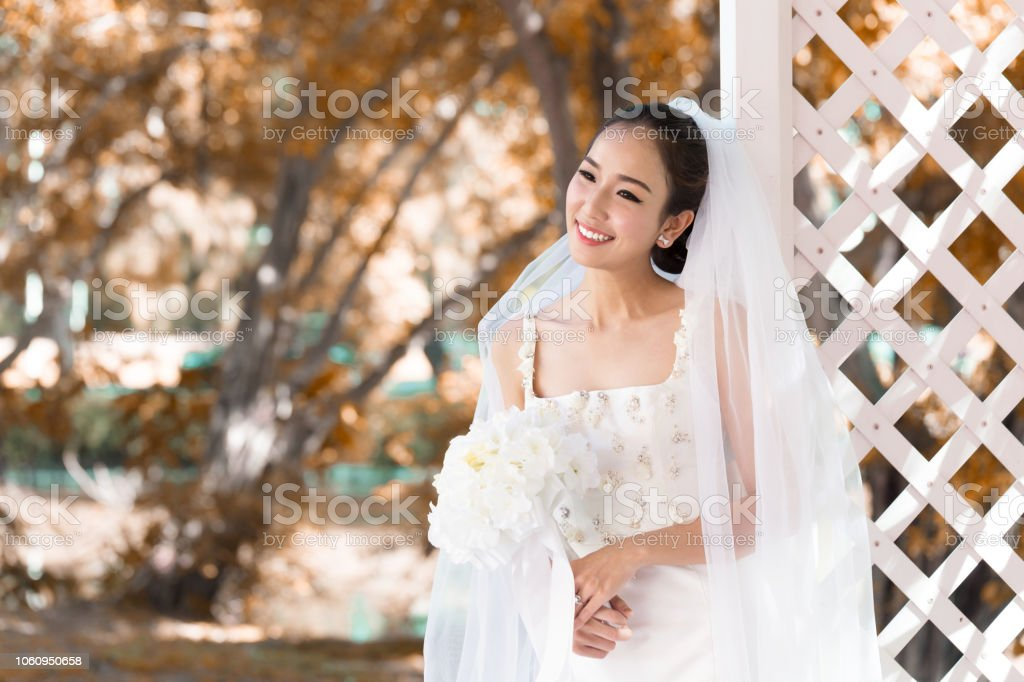 Wearing White To A Wedding.Beautiful Attractive Asian Bride Woman Wearing White Wedding