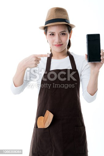 1066358064istockphoto beautiful attractive asian shop owner with apron present black screen smartphone with happiness and joyful business startup ideas concept 1066358064