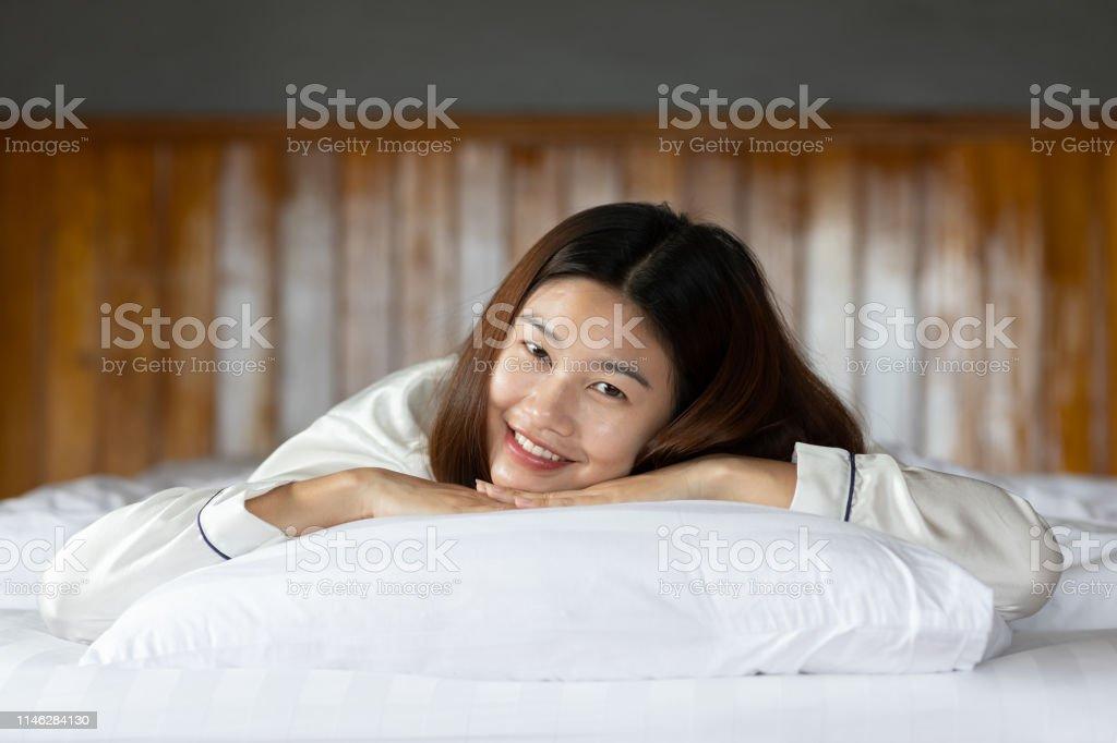 Beautiful Attractive Asian woman wearing Pajamas sleep smile sleep...