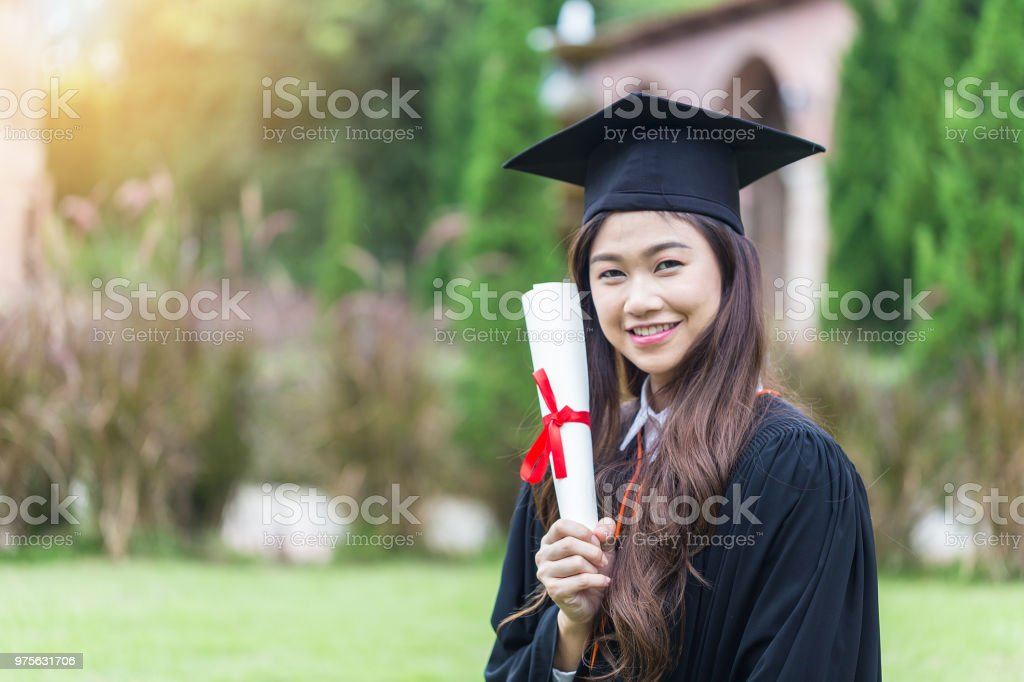 2ca688841c Beautiful Attractive Asian Women Student Graduate holding certificate in  her hand and feeling so proud and