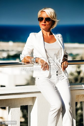 Beautiful Attractive Blonde Business Woman In White Suit
